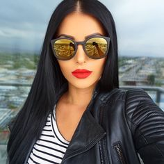 "No sun in sight but shades are necessary @quayaustralia wearing @colouredraine ""Vanity Raine"" on the lips /use code: amrezy for 10% of/ extensions by @bellamihair /code: amrezy for off/ #TGIF"
