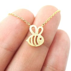 - Description - Details An adorable necklace featuring the cutest little bumble bee shaped charm in gold! This little bee is made with cut out details and a textured finish and is super pretty! Store
