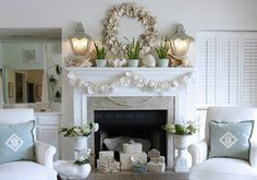 ❥ seashell wreath, fireplace, beautiful white furniture with blue pillows. very relaxing