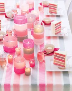 Combining color and a design element such -- such as these stripes of streamers -- gives decorations a powerful punch. Cover the table with white poster paper, and unroll streamers along its length, affixing them at intervals with double-sided tape. Top with glassine. For candleholders, use double-sided tape to attach streamers around glass holders.