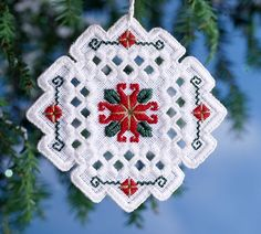Hardanger ornament by Patricia Andrle uses Kreinik silk threads. Free project to download from the Kreinik web site.