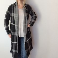Tea n Cup Black Plaid  Long Cardigan New with Tags. This is a One Size- please refer to measurements to determine the fit on you. I am wearing this in the cover shot and I wear a small/medium for reference.  Made of 60% cotton/40% acrylic. Has a nice weight to it but is not bulky- VERY comfortable!  Measurements: underarm to underarm flat across is approximately 21 inches. Back of neck to bottom of hem is approximately 37 inches. Tea n Cup Sweaters Cardigans