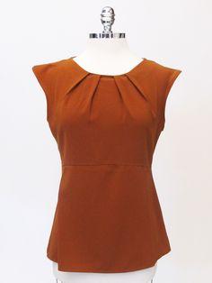 Azura Boutique - La Fee Maraboutee Short Sleeve Ruched Top, $174.00 (http://www.shopazura.com/la-fee-maraboutee-short-sleeve-ruched-top/)