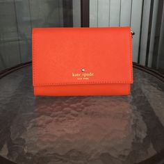Kate Spade Cami Crossbody This is an authentic Kate spade Cami Crossbody and the color orange. This has been used a few times, but is in good condition. ❌No trades!❌ kate spade Bags Crossbody Bags