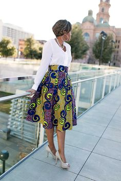 Skirt availablehere|Self Drafted – Tutorial here | Fabric –Ankara | Box pleated skirts are a classic piece that must have in your closet in a few different colors and fabrics. Variations of the hem length, texture, color, print, and fullness can create totally different looks. I admit, I did not have a box pleated skirt…