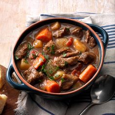 Slow Cooker Beef Stew Recipe -When there's a chill in the air, nothing beats this stew. Seasoned with thyme and dry mustard, the hearty slow-cooked stew is chock-full of tender carrots, potatoes and beef.—Earnestine Wilson, Waco, Texas
