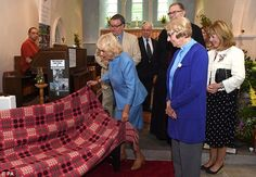 The Duchess of Cornwall unveils a commemorative bench during a visit to the Flower Festival at St Barnabas Church in Rhandirmwyn, Llandovery