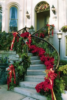 Stunning staircase...with garland, poinsettias and red bows. holiday, front steps, outdoor christmas decorations, stairway, christmas stairs, front doors, garland, savannah georgia, christmas staircase