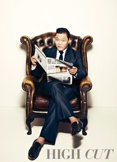 Psy (싸이) poses for his first solo photo spread in 'High Cut' magazine.