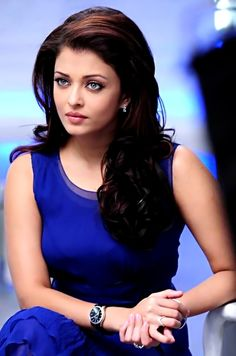 Aishwarya Rai - Clear Winter. Look at the amount of contrast her colouring can take! The blue is gorgeous on her.