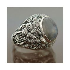 @Overstock - This men's moonstone ring is handmade to harness the beauty of this stone. Made under a partnership with National Geographic, the ring is engraved with a lion design, while the rainbow stone appears different colors in different light.http://www.overstock.com/Worldstock-Fair-Trade/Sterling-Silver-Lions-Charisma-Mens-Moonstone-Ring-Indonesia/4489449/product.html?CID=214117 $56.99