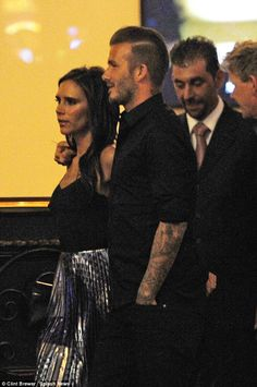 David Beckham slips a romantic arm around Victoria during night out - August 25, 2014