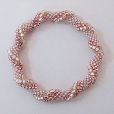 Bead Crochet Rope Bangle, Spiral Design in Rose Gold, Copper,... (1,855 DOP) ❤ liked on Polyvore featuring jewelry, bracelets, beaded bangles, rose gold bangle, beaded jewelry, red gold jewelry and bangle bracelet