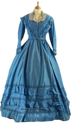 Afternoon dress, begun in the 1840s or 1850s and altered in later decades. Turquoise silk taffeta in 2 pieces. Tulle underskirt. Museo del Costume e della Moda Siciliana via Cultura Italia
