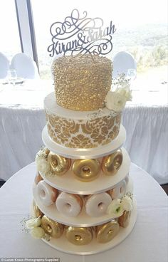 Special theme: As well as having a doughnut-inspired, golden-covered wedding cake, the couple also engaged in a Liverpool Krispy Kreme photo shoot, which was shot by the talented event photographer, Lucas Kraus Doughnut Wedding Cake, Wedding Donuts, Doughnut Cake, Wedding Cakes With Cupcakes, Cool Wedding Cakes, Wedding Cake Toppers, Cupcake Cakes, Krispy Kreme Wedding Cake, Beautiful Cakes