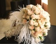 Feathers add to these pink roses