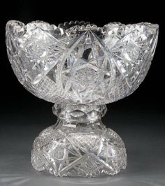 AN AMERICAN BRILLIANT PERIOD CUT GLASS PUNCH BOWL AND MATCHING STAND EARLY 20TH CENTURY, WITH HOBNAIL AND HOBSTAR CUT DESIGN ON A BELL-FORM BASE