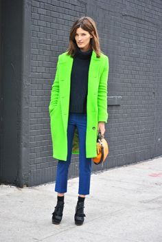 Bright lights, big city on the street at #NYFW. #NETaNYFW http://fashionfix.net-a-porter.com/fashion/neon-signs-2