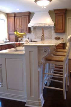 Kitchen Remodel (Cultivate.com); pretty island with corbels, like white with glaze