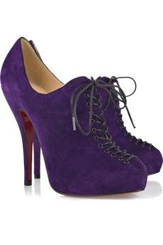 Christian Louboutin. I would wear with my purple suit and carry a fuschia bag.