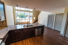 View from the kitchen inside our Loft floorplan.  Granite countertops, stainless steel appliances, and huge windows.  What more could you want? #livelikealegend #Nashville #DallasonElliston