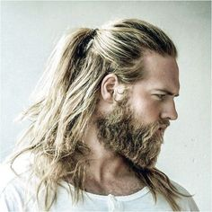 Love this half pony-tail and the square cut beard fading into his furred chest #