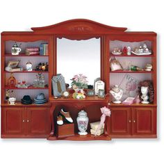 The boutique store display is a lovely cherry cabinet with all sorts of miniature items that might be found in upscale boutique store in an earlier time. There are hats, parasols, shirts, shoes, wigs,