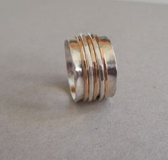 Sterling and Gold Spinner Ring- Fiddle Ring Silver and Gold. via Etsy.