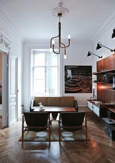 Masculine Scandinavian living room with original Finn Juhl furniture…