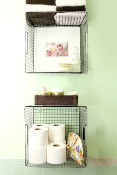 bathroom wall-mounted wire baskets storing toilet paper, toiletries, and towels - Use hooks to mount!