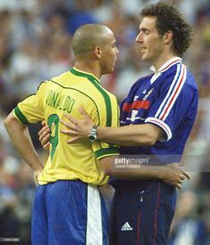 French player Laurent Blanc (R) congratulates Brazilian striker Ronaldo (L) 12 July at the Stade de France in Saint-Denis, near Paris, after host France beat defending champion Brazil 3-0 in the 1998 Soccer World Cup final.