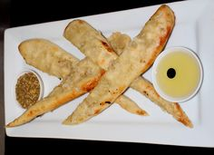 Tomi's Garlic Bread - two freshley baked flat breads drizzled with garlic served with dukkah and dipping oil Garlic Bread, Starters, Breads, Bacon, Oil, Flat, Breakfast, Bread Rolls, Morning Coffee