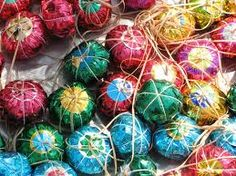 Those balls are not Christmas ornaments, but homemade sawdust filled toy balls similar somehow with yo yos. The gypsies were selling them in parks to grandmothers with bugging grandchildren :).