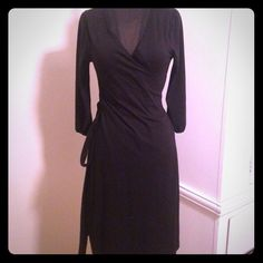 Old navy black wrap dress Comfortable black wrap dress. 3/4 length sleeves. Perfect for any occasion  Old Navy Dresses
