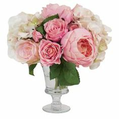 """Featuring faux cabbage roses and hydrangeas in a glass pedestal vase, this lovely arrangement brings a touch of natural style to your decor.     Product: Faux floral arrangementConstruction Material: Silk and glassColor: Pink, white and greenFeatures: Includes faux roses, hydrangeas and cabbage rosesDimensions: 12"""" H x 13"""" Diameter"""