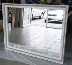 Beautiful triple framed mirror, stacking frames leads to beautiful frames.