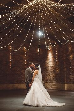 Bride & Groom First Dance under a canopy of fairy lights - Image by  Christopher Currie Photography - An Essense of Australia wedding dress for a Winter wedding at  Kinkell Byre in Scotland with a pastel rose bouquet photographed by Christopher Currie.