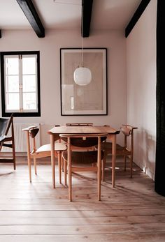 wood dining table and black beamed ceiling. / sfgirlbybay
