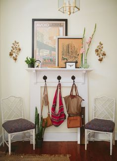 Lauren McCaul's Alabama Home #theeverygirl faux mantle for the foyer - cute front-door mudroom/catch-all area