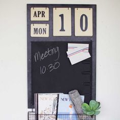 Calendar with Chalkboard, Note Clips & Basket - A one-stop organizer for daily to-do lists. Keep your routine organized with everything in one place and jot down daily reminders. Large paper clips run along the right edge. Perfect for shopping lists, pending invitations or a favorite photo.