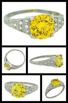 Art Deco 1.84ct Yellow Diamond Antique Engagement Ring. A fabulous diamond ring from the Art Deco (ca1920) era! Made of 18kt white gold, the ring has a gorgeous step-up design featuring a stunning, prong set 1.84ct old European Cut yellow diamond at the center.