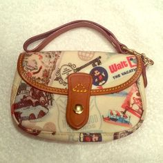Dooney and Bourke Disney clutch. This is one of the first Dooney and Bourke Disney designs. Hard to come by. Never used. In great condition! Dooney & Bourke Bags Clutches & Wristlets