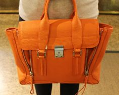For big impact, it's all about burnt orange hues. Do you love this Phillip Lim bag as much as we do?