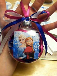 Handmade 2014 Frozen Christmas ball with Elsa and Anna photo cover and colorful bow ribbon decor - blue and pink ribbon filing, Christmas tree craft Frozen Christmas Tree, Christmas Snow Globes, Christmas Ornaments To Make, Christmas Tree Themes, Disney Christmas, Christmas Projects, Holiday Crafts, Christmas Crafts, Xmas Tree