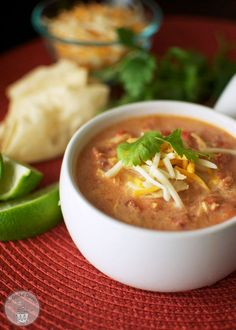 Crock Pot Chicken Tortilla Soup - made this for dinner the other night - my husband LOVED it! I added in a jalapeño for a little bit of extra kick YUMMY and perfect tortilla soup!