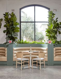 A former auto repair garage has been transformed by Mim Design into a contemporary hospitality space in the guise of a sprawling indoor botanical garden.