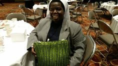 Sister Rosemary Nyirumbe spoke at Catholic Press Association's Media Conference last week on the work she's doing with Sisters United in Uganda. You can read the Catholic News Service story here: http://osv.cm/1R1XVkc. She's holding her super-cute and amazing brilliantly green pop-tab purse, made by the young women of Uganda and South Sudan. You can read that story here: http://osv.cm/1egITVQ