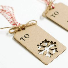 Really simple idea for gift tags - luggage labels with cut-out shape & raffia, string or ribbon