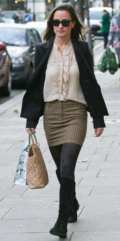 DECEMBER 8, 2011 We spotted Pippa taking a break from her work day in a professional yet trendy outfit. Her ruffled shirt and patterned mini offer just the right amount of detail without going overboard. She streamlined the look even more by adding a blazer and black knee-high boots.