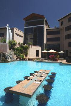Dinner is served at the....pool (Tribe Hotel – Nairobi, Kenya)